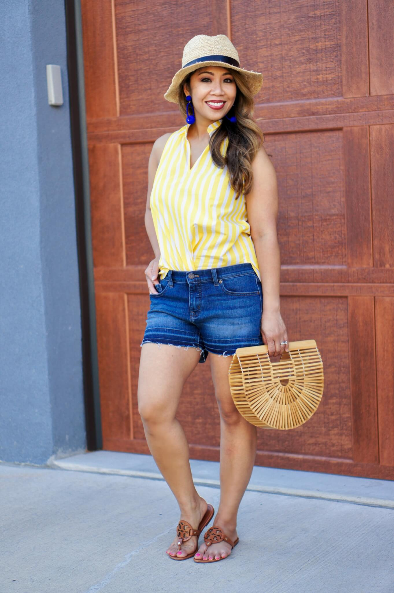 c2a07f8dbe9 Photos by Sanglui. Top by J. Crew. Shorts by Banana Republic. Bag by  Francesca s. Sandals by Tory Burch. Hat by Gap.